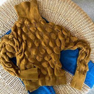 Bubble knit turtleneck sweater